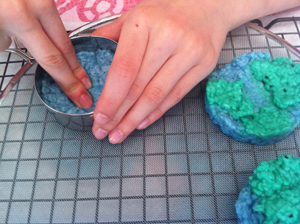 Earth day activity seed paper globes put the piece of screen material over the cooling rack place the biscuit cutter on the screen spoon some of the blue pulp into the center of the biscuit mightylinksfo