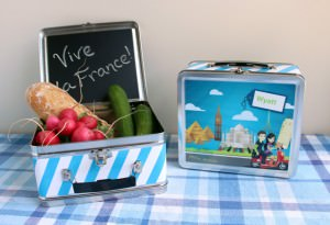 Little Passports Sam & Sofia Lunchbox filled with baguette, radish and cucumbers