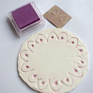 Little Passports Blog Make Your Own Diya Stamped Purple Design Border on Air Clay