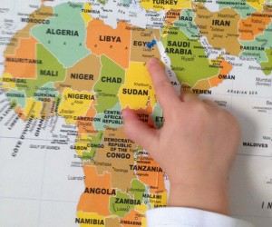 Child pointing on map on Africa