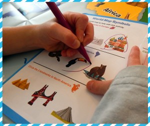 Review for Early Explorers Photo Child Circling Toucan in Activity Book