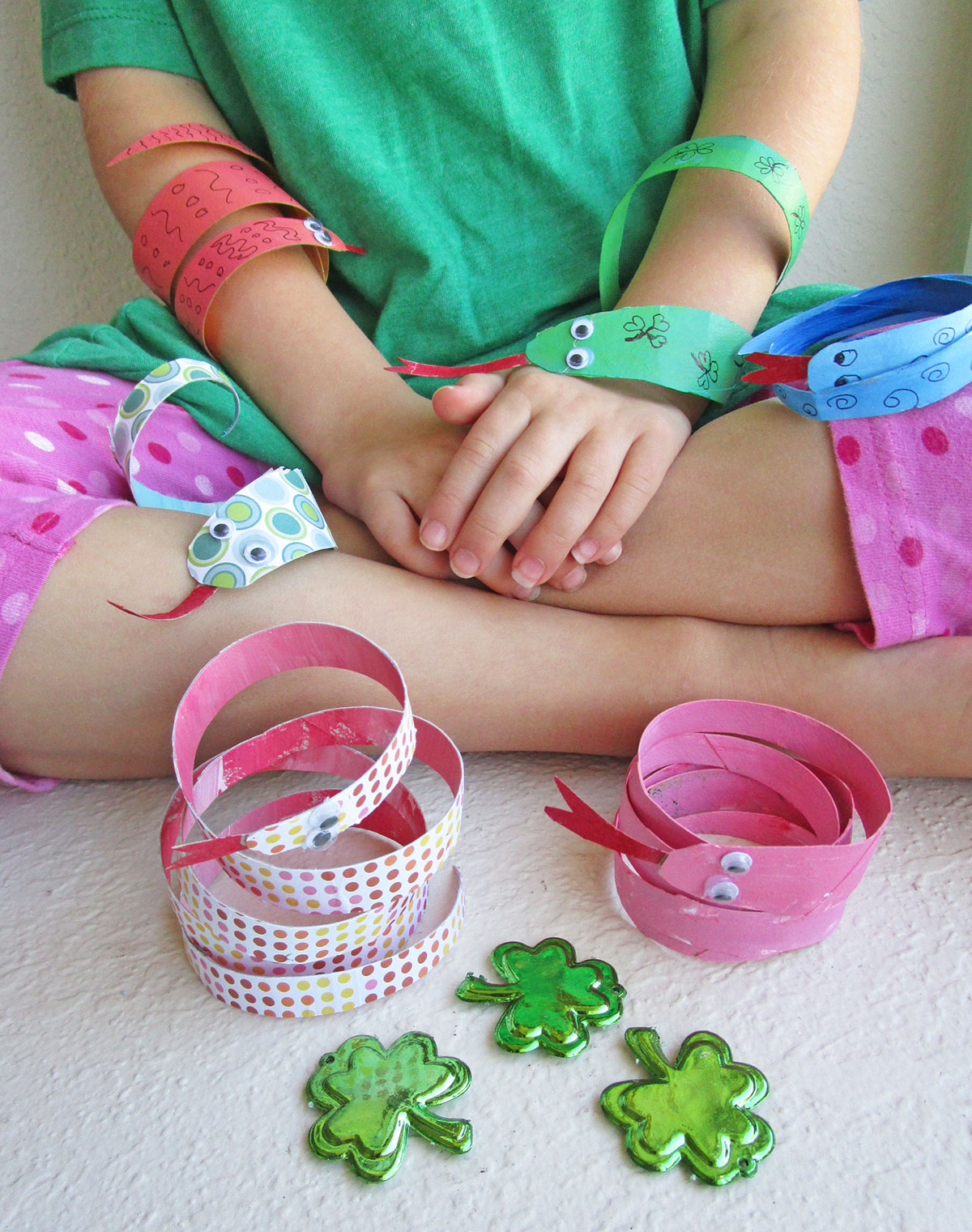 Little Passports Blog St. Patrick's Day Snake Craft Girl with Completed Snakes