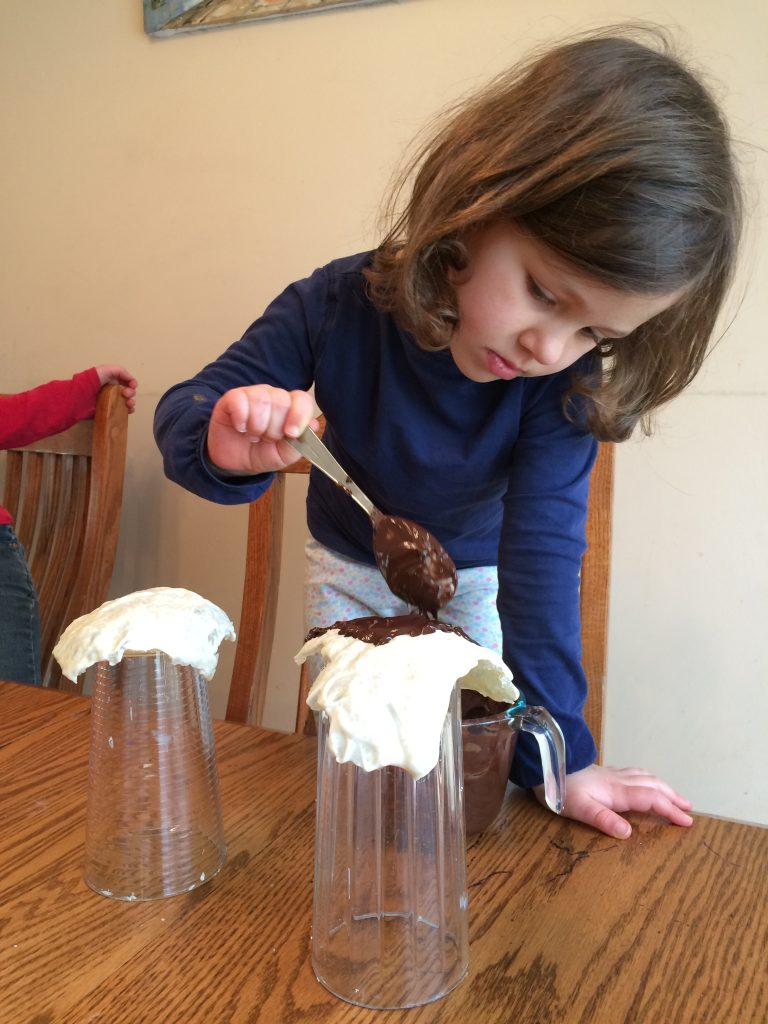 Girl placing melted chocolate over edible geode