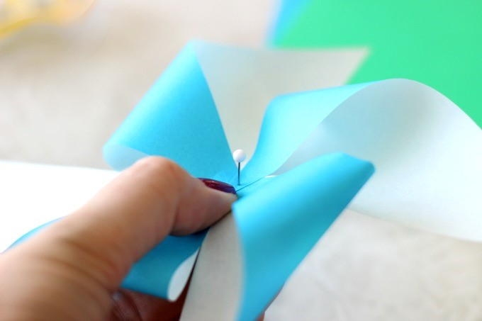 Little Passports Blog DIY Pinwheel Craft Using Sewing Pin to Poke Hole in Middle
