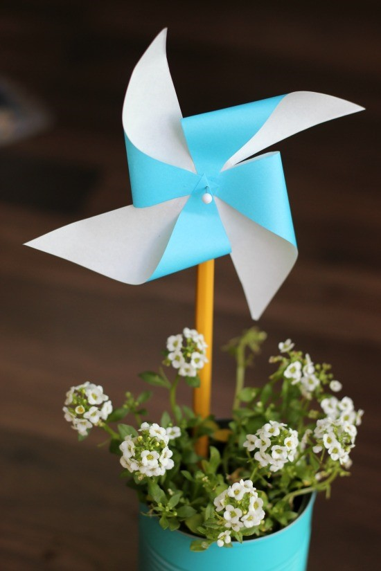 Little Passports Blog DIY Pinwheel Craft Completed Pinwheel in Small Blue Painted Pot