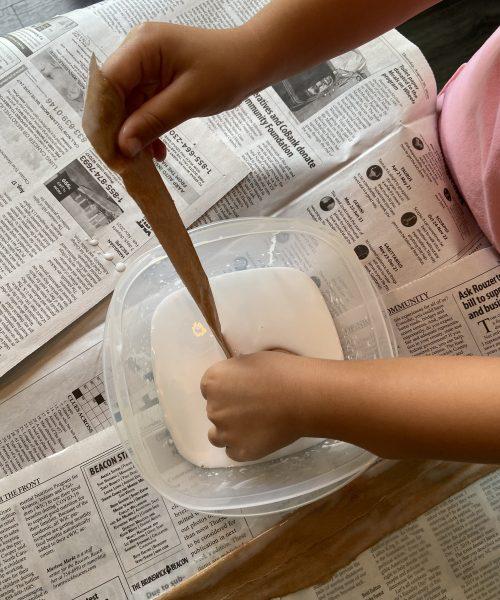 create a papyrus scroll step 4: dip each paper strip into the glue mixture