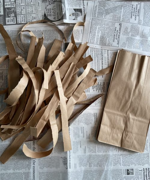 create a papyrus scroll step 2: tear paper bags into half inch strips