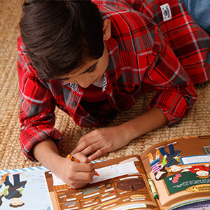 Boy with USA activity journal