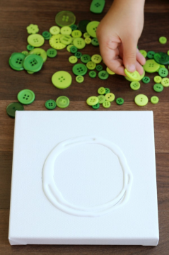 How to make a button wreath with Little Passports step 1: Apply glue in a circular shape