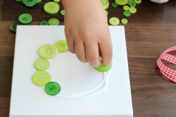 How to make a button wreath with Little Passports step 2: Place buttons onto glue circle