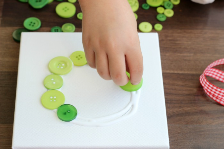 Place buttons onto glue circle