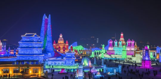 Full lighted cityscape of ice sculpture at the Harbin International Ice and Snow Sculpture Festival