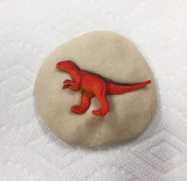 Press the dinosaur into the salt dough for your fossil
