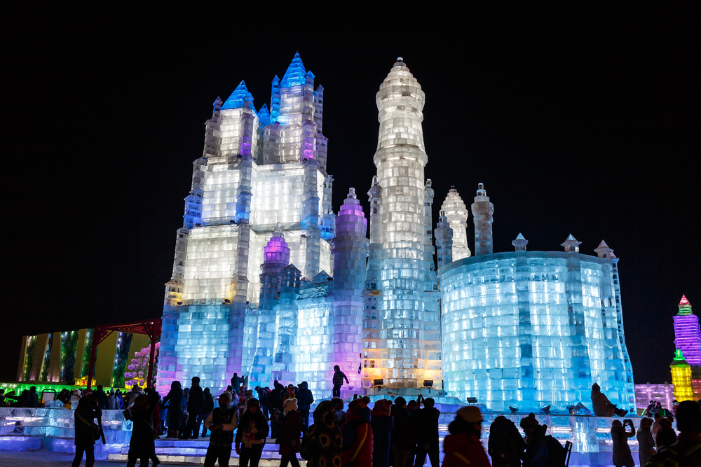 A full size building made out of ice and illuminated at the Harbin Ice and Snow Sculpture Festival