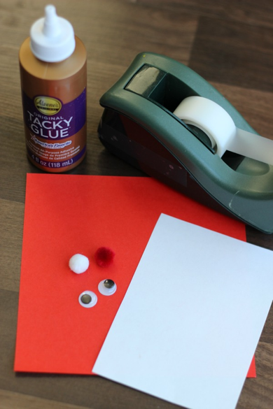 Supplies to make a Santa cone craft with Little Passports