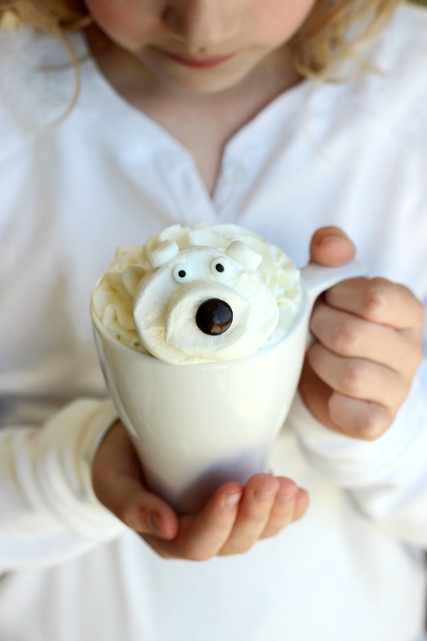 Child holding hot chocolate