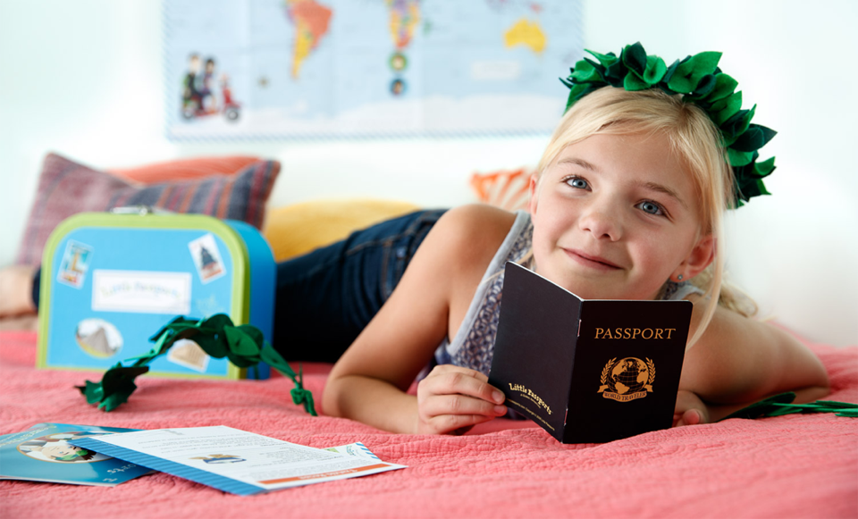 Girl wearing wreath reading passport