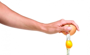 Hand cracking an egg image