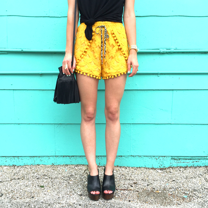 livvyland-blog-olivia-watson-austin-texas-fashion-style-lifestyle-blogger-bloggers-yellow-pom-pom-shorts-mule-wedges-fedora-hat-what-to-wear-trendy-outfit-atx-fashion-fringe-bucket-bag-music-festival-x-games-acl-fest-4