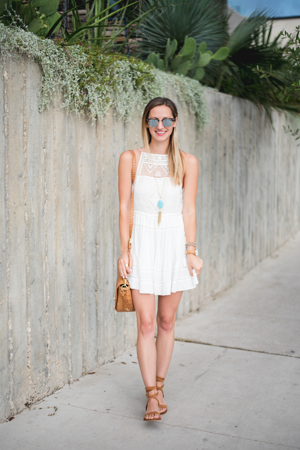 livvyland-blog-olivia-watson-austin-texas-fashion-blogger-free-people-flowy-white-high-neck-crochet-dress-tassel-south-lamar-kathryn-frazer-photography-boho-festival-outfit-1