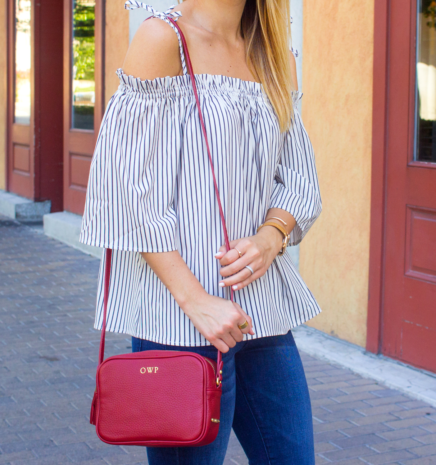 livvyland-blog-goodnight-macaroon-cold-shoulder-striped-top-austin-second-street-district-red-monogram-handbag-dl-1961-emma-jeans-10