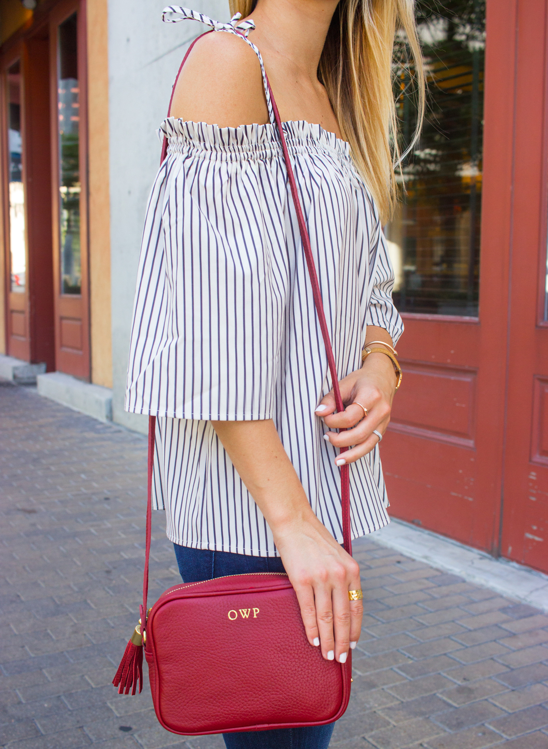 livvyland-blog-goodnight-macaroon-cold-shoulder-striped-top-austin-second-street-district-red-monogram-handbag-dl-1961-emma-jeans-12