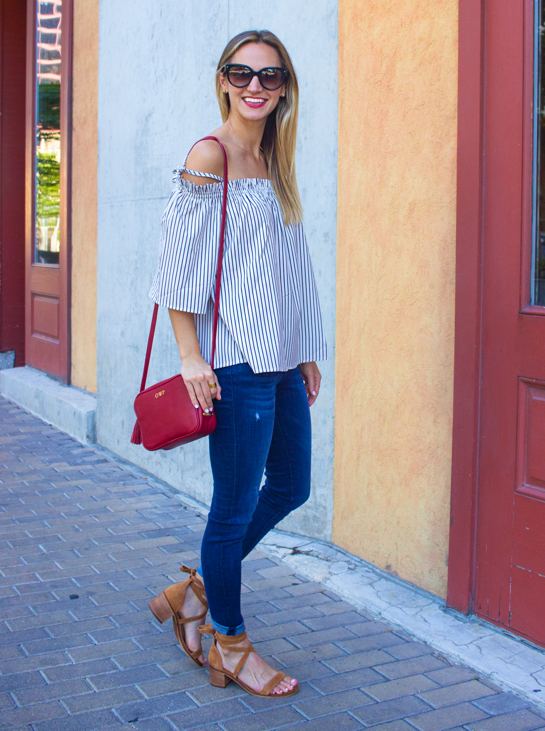 livvyland-blog-goodnight-macaroon-cold-shoulder-striped-top-austin-second-street-district-red-monogram-handbag-dl-1961-emma-jeans-2