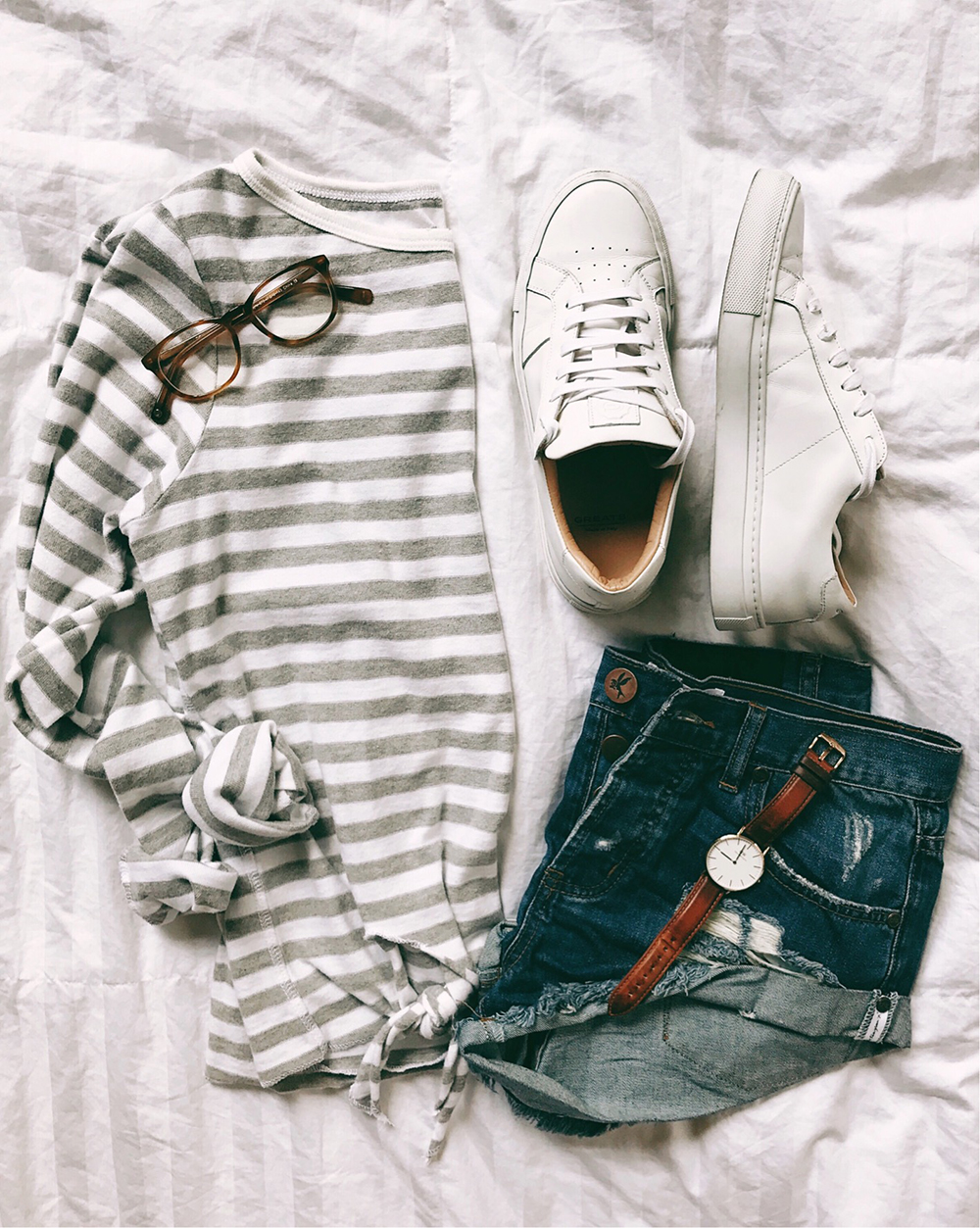 livvyland-blog-olivia-watson-flat-lay-outfit-striped-tie-front-top-white-greats-royal-sneakers-one-teaspoon-bandit-shorts