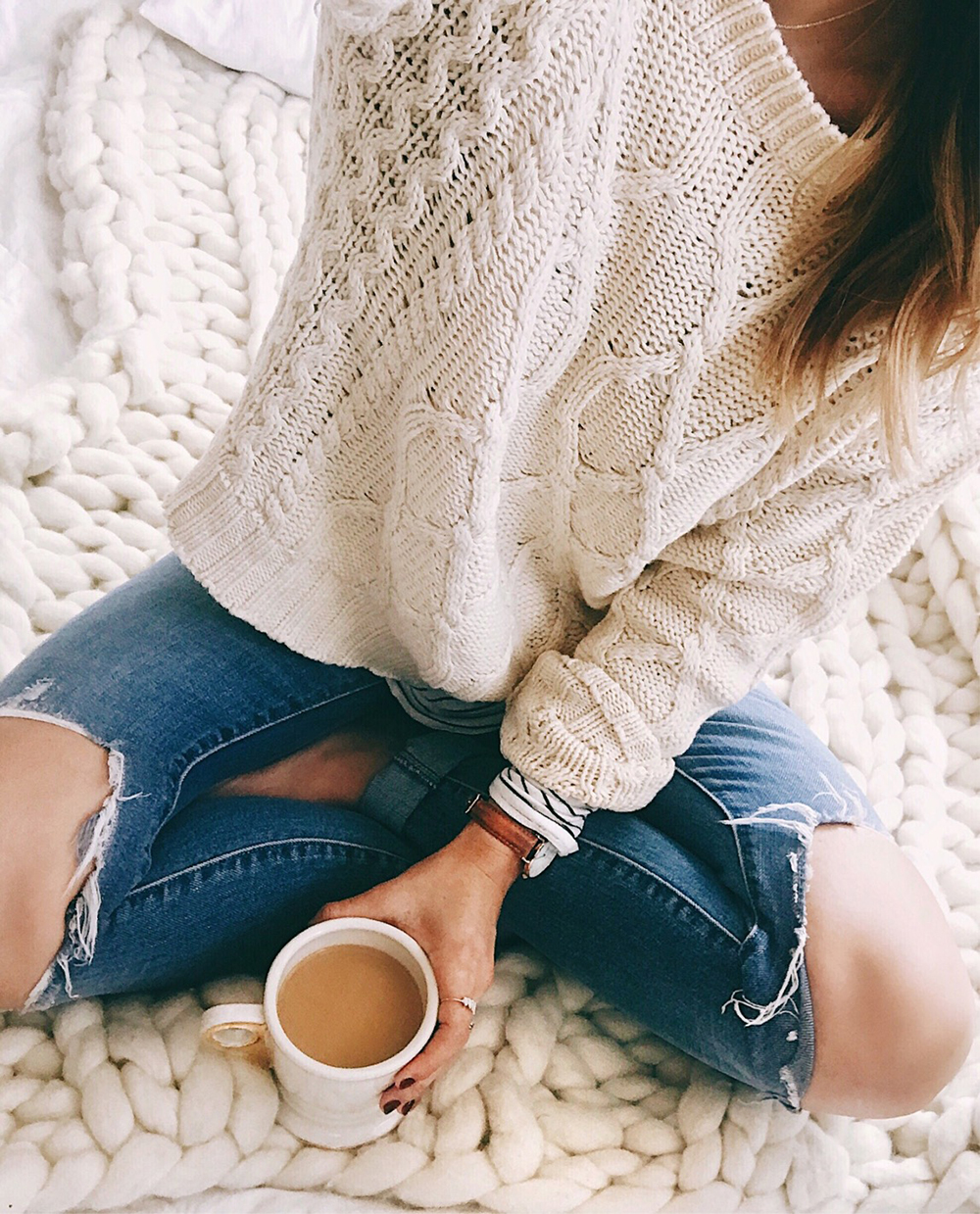 livvyland-blog-olivia-watson-fall-outfit-cableknit-sweater-layers-striped-tee-chunky-knit-throw-blanket