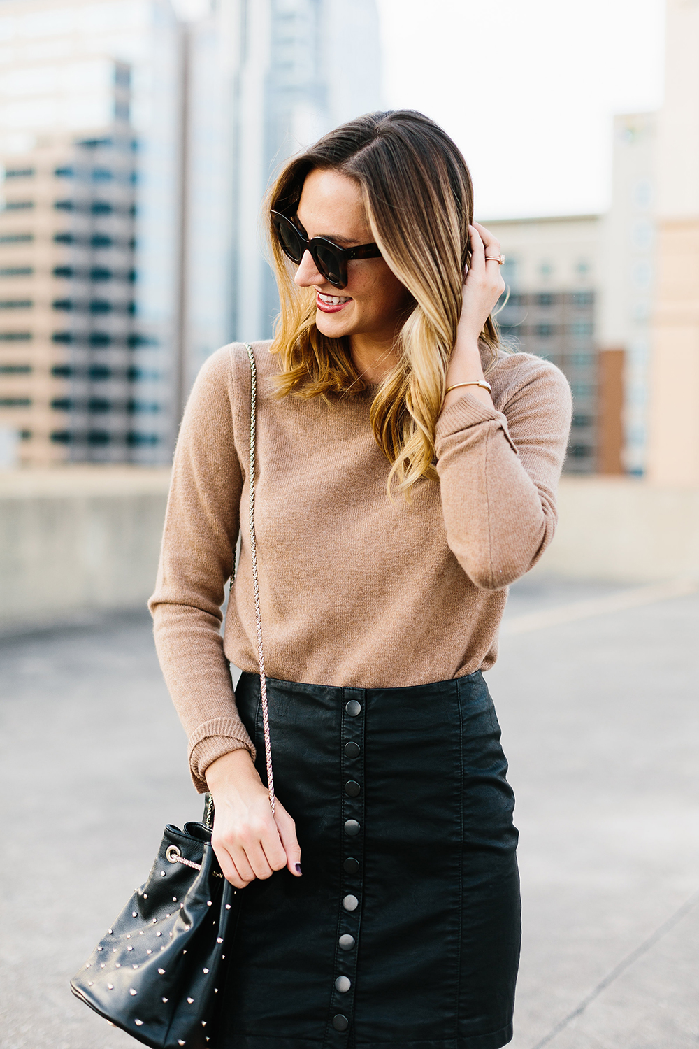 livvyland-blog-olivia-watson-free-people-vegan-leather-mini-skirt-cashmere-tan-sweater-sezane-studded-bucket-bag-5