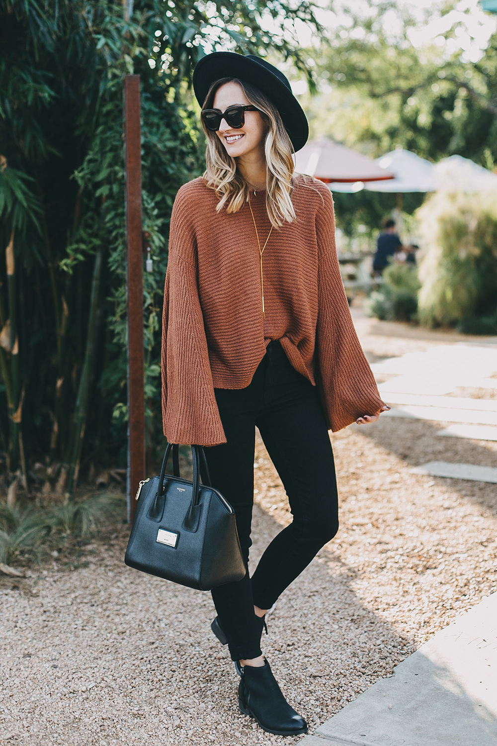 livvyland-blog-olivia-watson-austin-texas-fashion-lifestyle-blogger-fall-orange-slouchy-sweater-black-skinny-jeans-outfit-boho-fall-idea-1