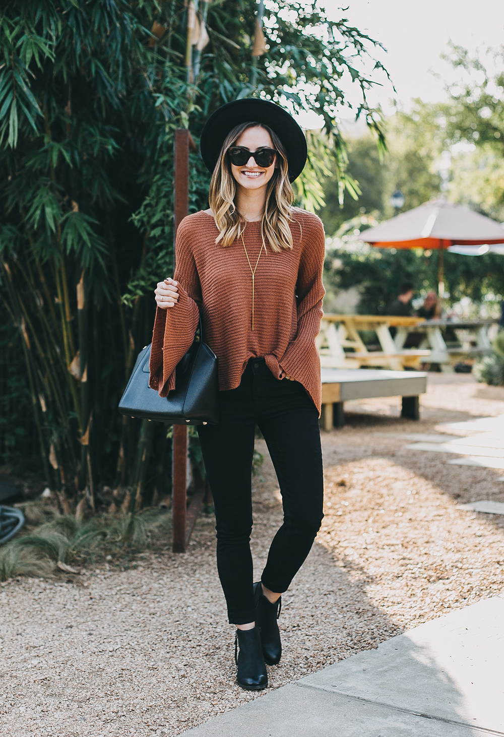 livvyland-blog-olivia-watson-austin-texas-fashion-lifestyle-blogger-fall-orange-slouchy-sweater-black-skinny-jeans-outfit-boho-fall-idea-6