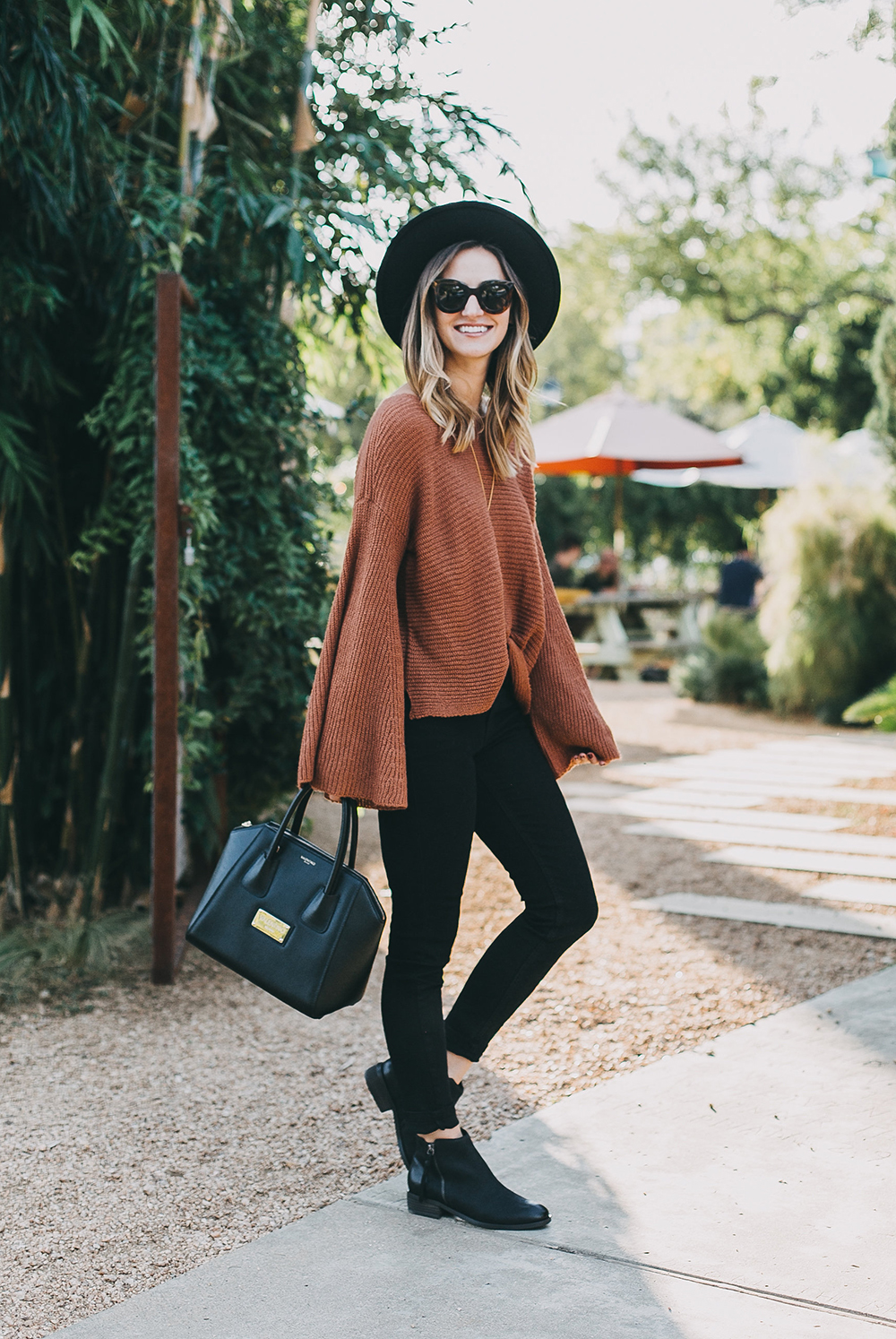 livvyland-blog-olivia-watson-austin-texas-fashion-lifestyle-blogger-fall-orange-slouchy-sweater-black-skinny-jeans-outfit-boho-fall-idea-7
