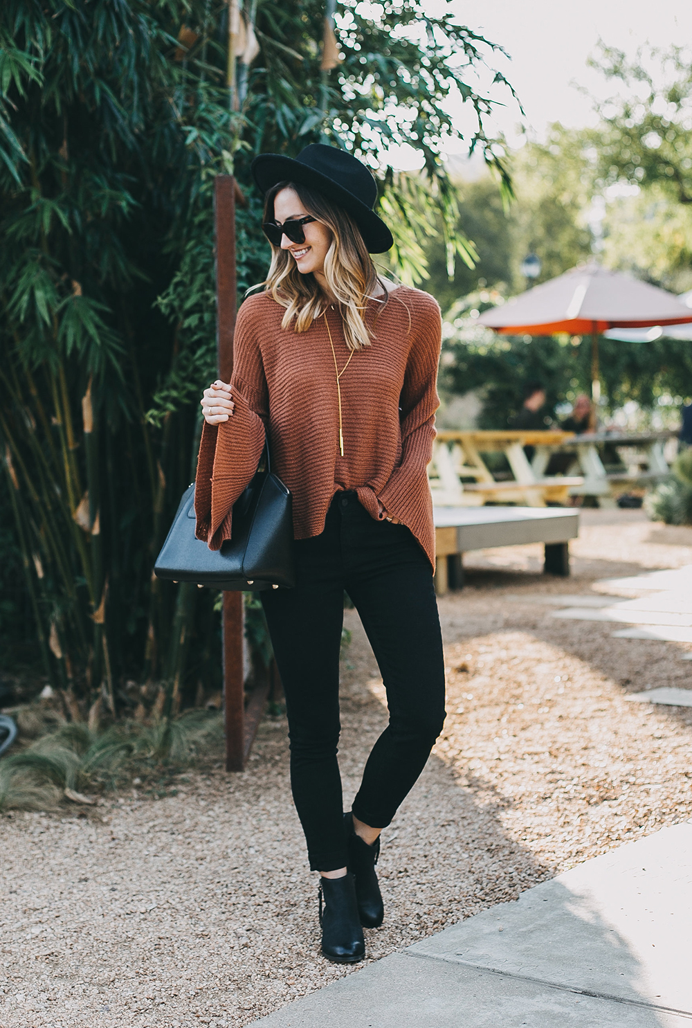 livvyland-blog-olivia-watson-austin-texas-fashion-lifestyle-blogger-fall-orange-slouchy-sweater-black-skinny-jeans-outfit-boho-fall-idea-8