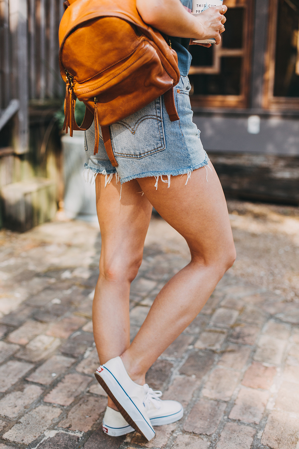 livvyland-blog-olivia-watson-austin-texas-fashion-style-urban-outfitters-striped-vintage-tee-levis-denim-wedgie-shorts-madewell-mini-leather-backpack-4
