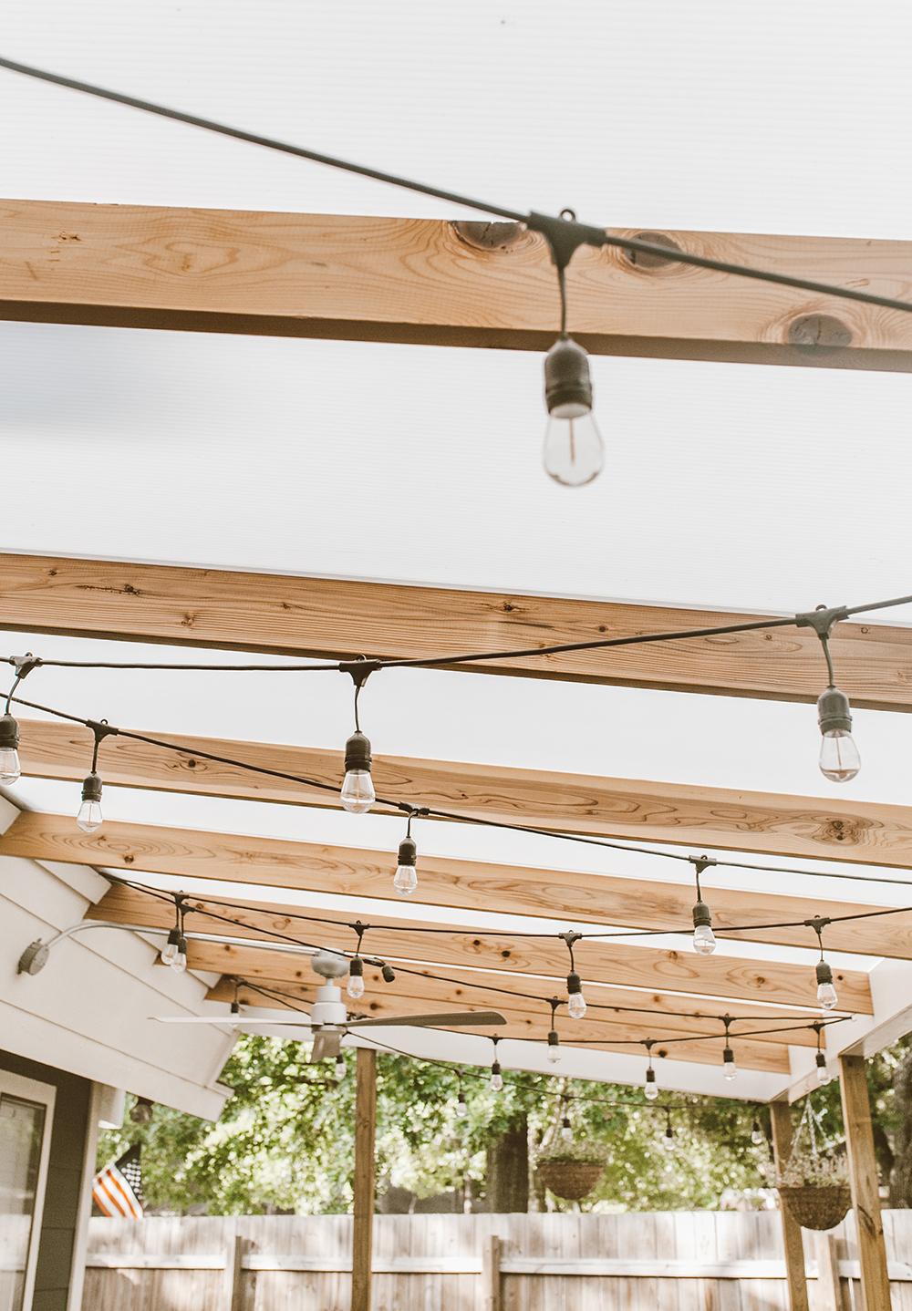 livvyland-blog-olivia-watson-backyard-patio-renovation-cover-polygal-roof-strand-lights-1