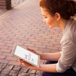 Woman Holding iPad Mockup