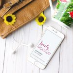 White iPhone Mockup With Sunflowers