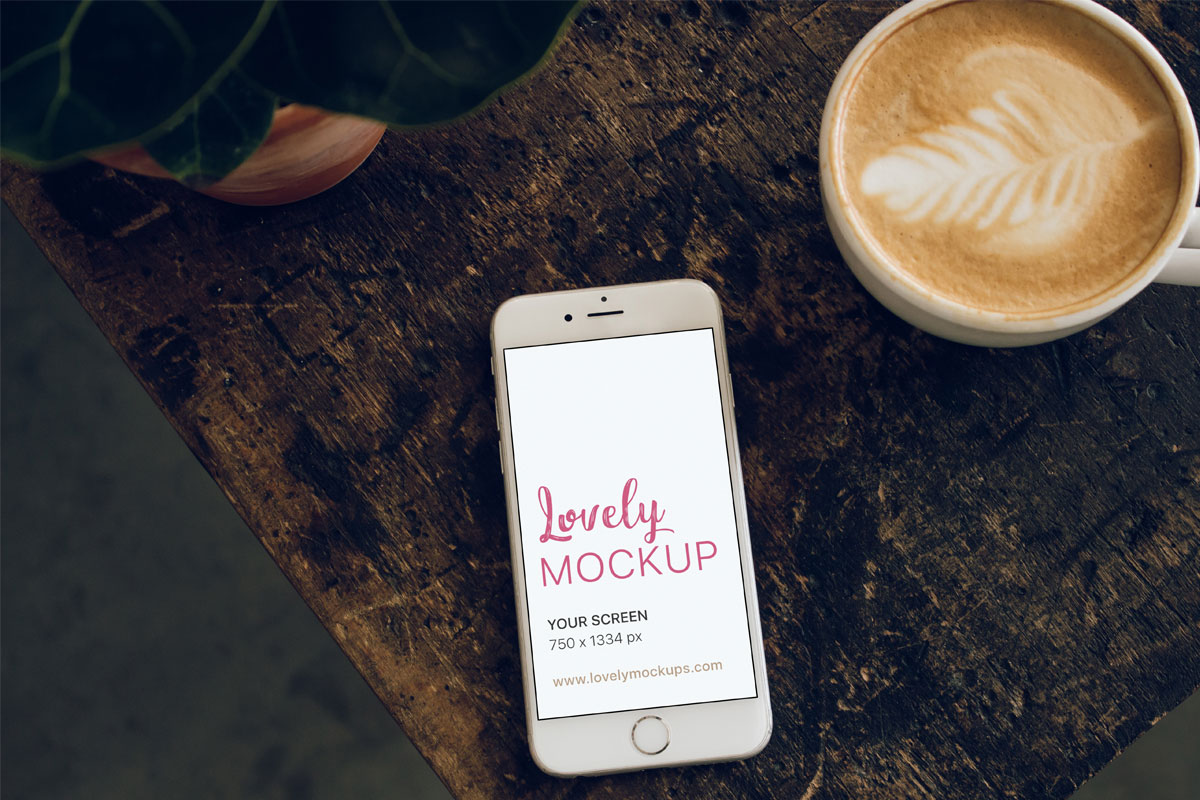 White Iphone Mockup With Coffee Mug And Vintage Wooden Table