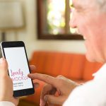 Mockup Template of Elderly Man With iPhone at Home Featured