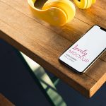Mockup of an iPhone Resting on a Wooden Table Featured