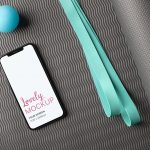 Mockup of an iPhone on a Yoga Mat Featured