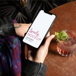 iPhone Mockup Featuring a Woman Having a Cocktail Featured
