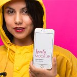 Mockup of an iPhone and a Woman in a Yellow Raincoat Featured