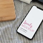 iPhone Mockup Surrounded by a Knife and a Cutting Board Featured