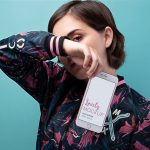 iPhone Mockup of a Woman Covering her Face Featured