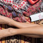 iPhone Mockup Next to a Sunbathing Womans Legs featured