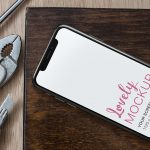 iPhone Mockup on a Workshop Table featured