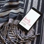 Mockup of an iPhone Lying on a Wool Blanket Featured