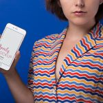 iPhone Mockup of a Woman in a Colorful Striped Shirt featured